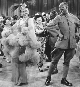 "Bill ""Bojangles"" Robinson and Lena Horne in ""Stormy Weather"""